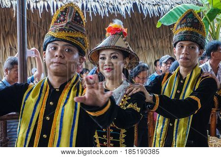 Penampang,Sabah-May 30,2016:Group of Sabah,Borneo Kadazandusun ethnic in their traditional costumes performs traditional dance during Harvest Festival at Penampang,Sabah,Malaysia