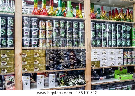 AMSTERDAM , NETHERLANDS - APRIL 31, 2017 : Window of a coffee shop displays a huge variety of cannabis products in the streets of AMsterdam