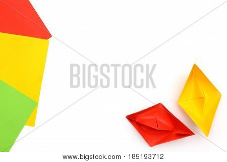 Yellow and red paper boats, origami, paper sheets, color paper sheets.