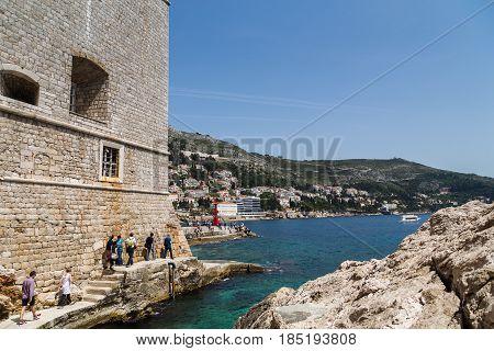 Tourists Walk Around St John's Fortress