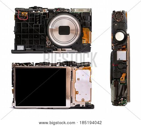Disassembled digital camera from different angles. Details of the broken camera isolated on white background. Repair of photographic technique.
