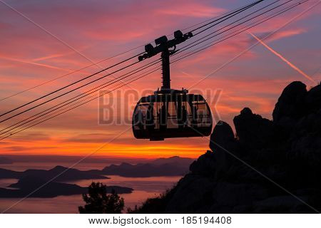 The cable car which shuttles tourists from Dubrovnik's old town to the peak of Srd Hill captured at sunset.