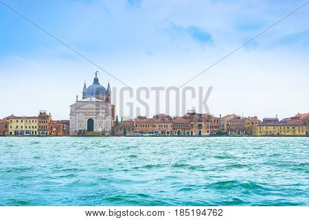 Venice Italy - April 27 2017: Beautiful canal church and Venice residential style beside Grand Canal in Venice Italy.