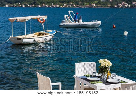 A table set up on a quayside restaurant in Perast Montenegro.
