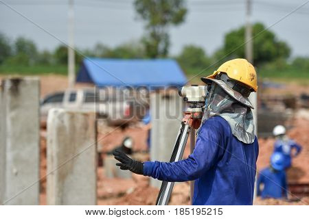 Surveyor engineer with partner making measure on the field,Surveyor equipment tacheometer or theodolite outdoors at construction site