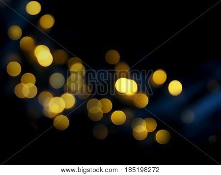 Dark abstract blured background with golden bokeh.