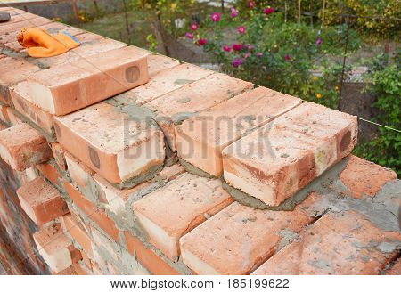 Bricklaying Brickwork. Bricklaying on House Construction Site. Building Home wall from Bricks