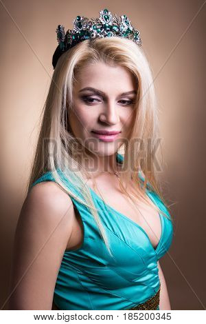 Beautiful Woman In Crown Over Beige