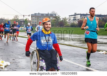 Krakow, Poland - April 30, 2017: Unidentified Handicapped Man In Marathon On A Wheelchair On The Cit
