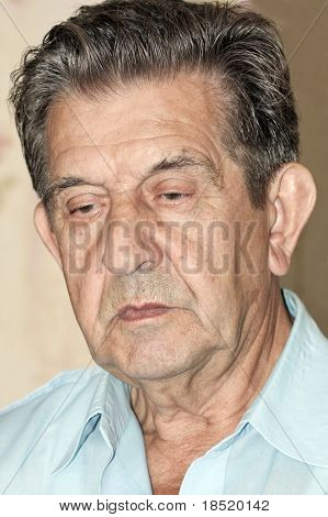 portrait of an elderly man looking seriously poster