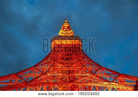 Spectacular perspective view of Tokyo Tower illuminated at night. The Tokyo Tower is a telecommunications building and also a panoramic observatory located in Minato district, Tokyo, Japan.
