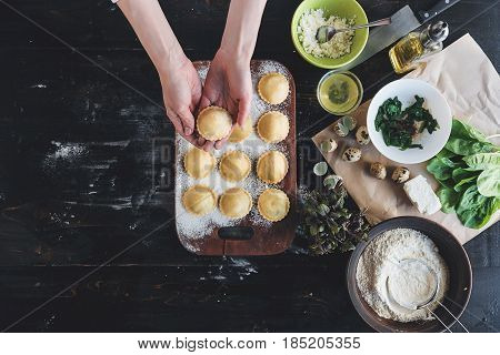 Step By Step The Chef Prepares Ravioli With Ricotta Cheese, Yolks Quail Eggs And Spinach With Spices