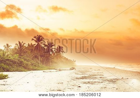 View over sunset over tropical beach by Palomino in Colombia