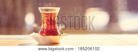Hot Turkish Tea Outdoors Near Glass Wall. Turkish Tea And Traditional Turkish Culture Concept