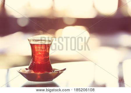 Hot Turkish Tea Outdoors Near Glass Wall. Turkish Tea And Traditional Turkish Culture Concept