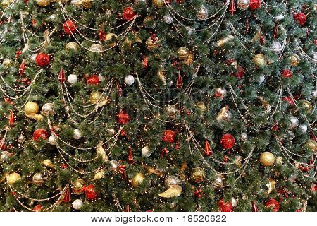 Christmas tree background with many decorations