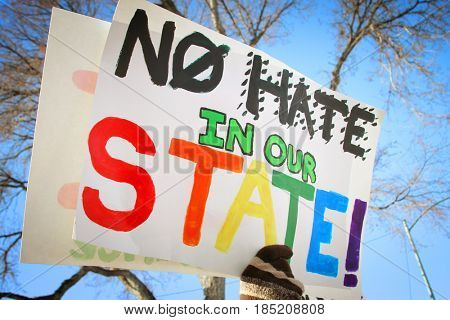 HELENA, MONTANA, USA - January 21, 2017: Protester holding No Hate In Our State sign at Women's March on Montana.