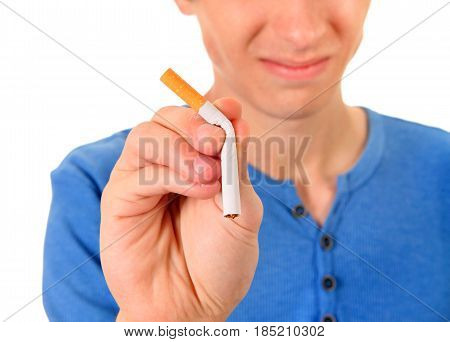 Young Man Destroy a Cigarette on the White Background. Focus on the Hand