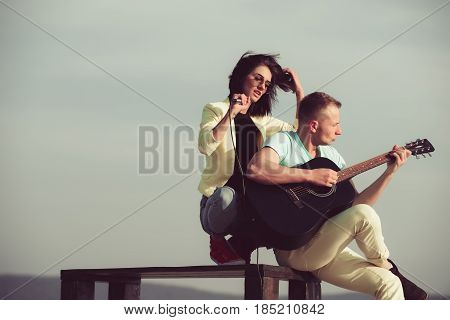 Pretty Woman Singing And Handsome Man Playing Guitar