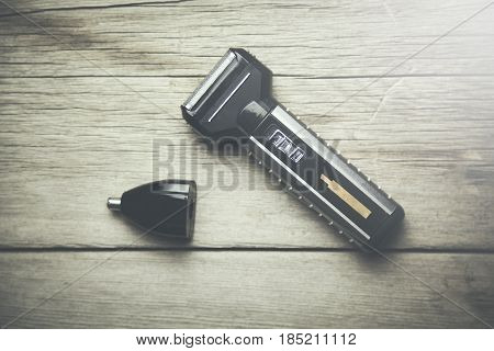 Machine for hair on the  wooden background