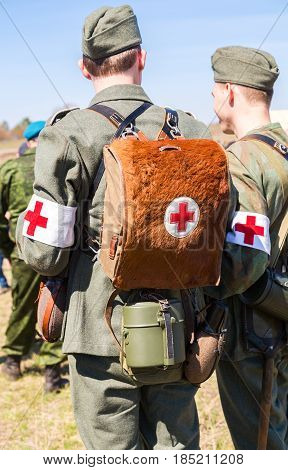 Samara Russia - April 30 2017: Unidentified re-enactors dressed as German military paramedic with a red cross brassard and medical bag