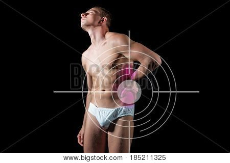 Man Suffers From Attack Of Appendicitis Standing Over Black Background