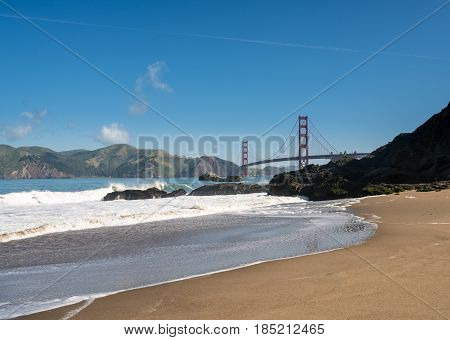 Marin Headlands with the Golden Gate Bridge taken from Baker Beach in San Francisco on clear spring day
