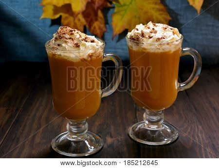 Hot vegetable beverage. Pumpkin latte with whipped cream and cinnamon in glasses