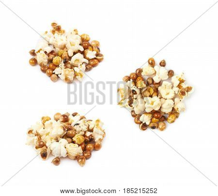 Pile of semi-cooked popcorn kernels isolated over the white background, set of three different foreshortenings