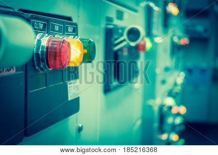 Vintage and blur tone of Electrical switchgear roomIndustrial electrical switch panel on plant and process control with grainy style.