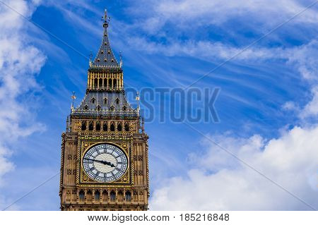 Detail Of The Big Ben Clock Tower  Surrounded By A Pretty Blue Sky With Fluffy Clouds