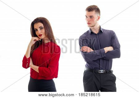a young boy cupped his hands and looking at the beautiful girl in a red blouse wistful isolated on white background