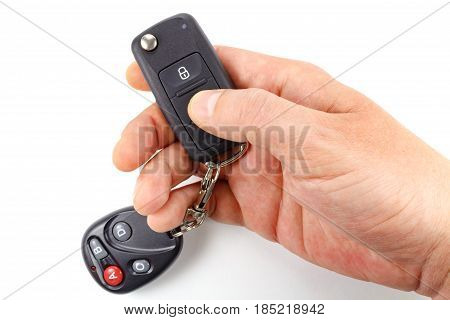Man presses button on the ignition key on a white background