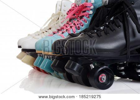 closeup row of quad roller skates on white
