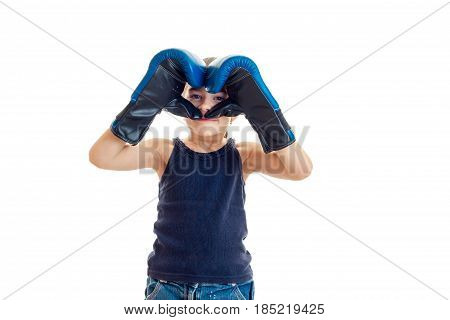 small child worth the closing person hands in boxing gloves is isolated on a white background