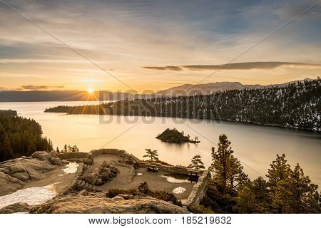 Sunrise at Emerald Bay on Lake Tahoe between California and Nevada with snow covered Sierra Nevada Mountains