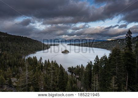 Sunset at Emerald Bay on Lake Tahoe between California and Nevada with snow covered Sierra Nevada Mountains