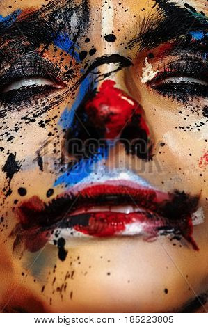 Horror Clown Woman with white Eyes. Creative Halloween Face Art