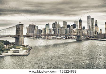 Manhattan skyline with Brooklyn Bridge at twilight - HDR image.