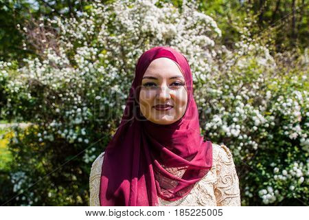 Young And Beautiful Girl Covered, Muslim, In The Sumptuous Dress Enjoying Spring Day Filled With Sun