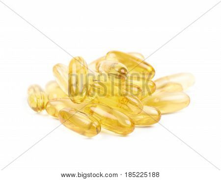 Pile of yellow softgel medical pills isolated over the white background