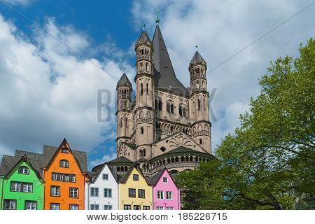 Old houses St. Martin Church Cologne Germany. Facade of colorful buildings in Cologne old town on Rhine river embankment. Beautiful european architecture North Rhine-Westphalia Rhineland Europe