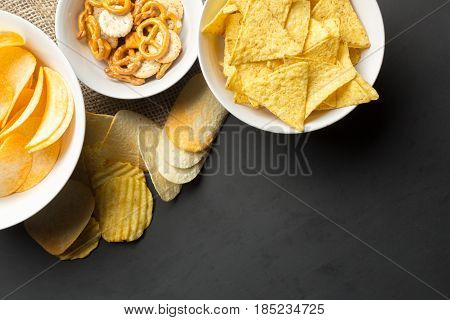 Salty snacks. Pretzels chips crackers. top view