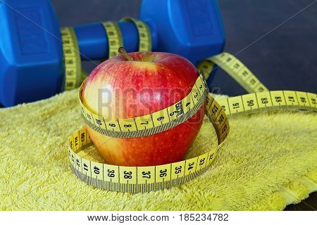 Equipments and fruits to maintain good fitness and optimum weight. Workout as a healthy way of life.