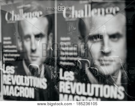 STRASBOURG FRANCE - MAY 7 2017: Macron revolution poster with pedestrians reflection in Press kiosk during the second round of the French presidential election to choose between Emmanuel Macron and Marine Le Pen