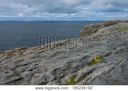 A view of the cliffs edge in Doolins Bay, The Burren, County Clare, Ireland