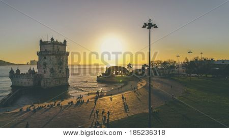 Aerial panorama of Belem Tower and Belem district at sunset.Tower of St Vincent on the bank of the Tagus River with discovery monument and 25 April bridge.Lisbon,Portugal.Amazing destinations