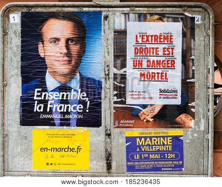 STRASBOURG FRANCE - MAY 7 2017: Extreme right is a deadly danger - extreme droite est un danger mortel poster over Le Pen poster near Emmanuel Macron clean one during French Elections