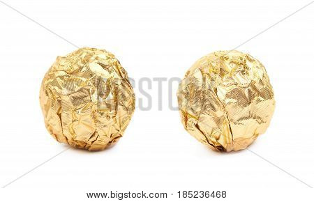 Ball confection candy in a golden foil wrapper isolated over the white background, set of two different foreshortenings
