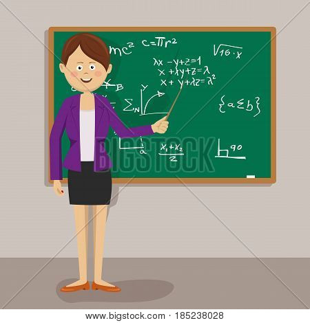 Female cute teacher standing with pointer next to blackboard in classroom
